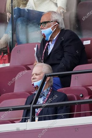 Owner of West Ham United David Gold watches the game without wearing a mask