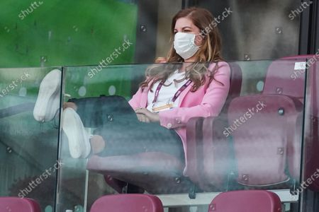 Karren Brady, Vice-Chairman of West Ham United, wears a mask as she watches the game in the directors box