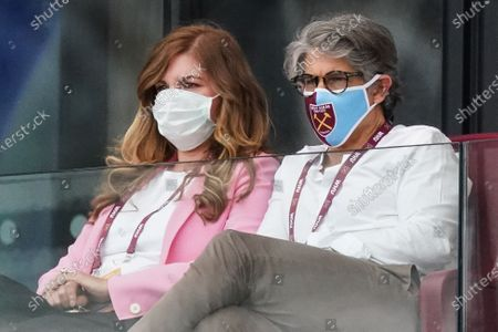Karren Brady, Vice-Chairman of West Ham United and her husband Paul Peschisolido wear masks as they watch the game from the directors box