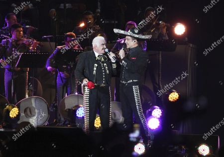 """Mexican singer Vicente Fernandez sings with his son Alejandro during a free concert at the Azteca Stadium in Mexico City. Twenty eight years after their first and only duet for Alejandro Fernandez's debut album, father and son release """"Menti,"""" included in Alejandro's """"Hecho en Mexico,"""" with an animated video that was released on"""