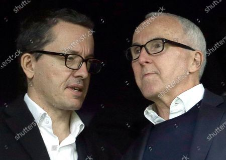 Owner of the Olympique de Marseille soccer club, Frank McCourt, right, speaks to Olympique Marseille President Jacques-Henri Eyraud during the League One soccer match between Marseille and Caen, in Marseille, southern France. Marseille must pay UEFA several millions euros (dollars) for breaking rules that monitor club finances but retains its Champions League place. Their place in the Champions League group stage was earned by coach Andre Villas-Boas's team being second to French champion Paris Saint-Germain when the league was ended early during the pandemic. Villas-Boas revived the 1993 European champion after being hired by Frank McCourt, the former Los Angeles Dodgers owner