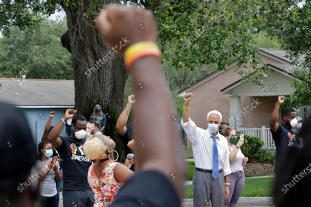 Rep. Charlie Crist, D-Fla., second from right, stands in solidarity with guests during a Juneteenth 2020 celebration outside the Dr. Carter G. Woodson African American Museum, in St. Petersburg, Fla. Juneteenth marks the day in 1865 when federal troops arrived in Galveston, Texas to take control of the state and ensure all enslaved people be freed