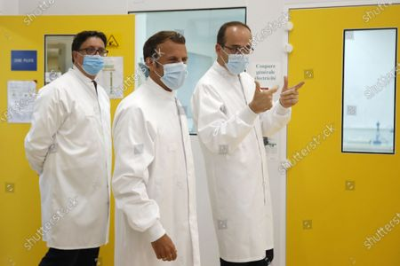 French President Emmanuel Macron, Thomas Triomphe, Executive Vice President of Sanofi Pasteur, and Paul Hudson, Chief Executive Officer of Sanofi, visit an industrial development laboratory at the French drugmaker's vaccine unit Sanofi Pasteur plant in Marcy-l'Etoile, near Lyon, France, June 16, 2020.
