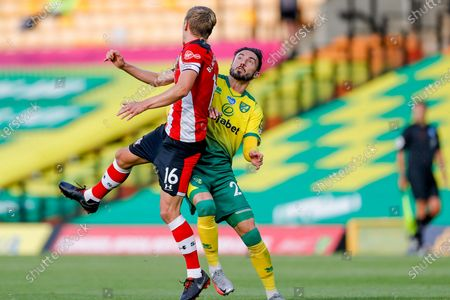 Southampton midfielder James Ward-Prowse (16) mussels with Norwich City forward Josip Drmic (20)   during the Premier League match between Norwich City and Southampton at Carrow Road, Norwich