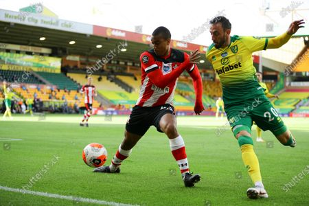 Van Valery of Southampton FC (L) and Josip Drmic of Norwich City (R) in action during the English Premier League soccer match between Norwich City and Southampton FC in Norwich, Britain, 19 June 2020.