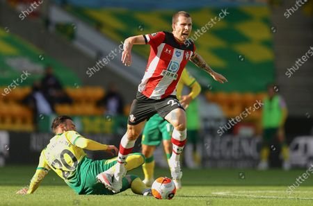 Josip Drmic of Norwich City (L) and Pierre-Emile Hojbjerg of Southampton FC (R) in action during the English Premier League soccer match between Norwich City and Southampton FC in Norwich, Britain, 19 June 2020.