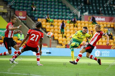 Josip Drmic of Norwich City (2-L) and James Ward-Prowse of Southampton FC (R) in action during the English Premier League soccer match between Norwich City and Southampton FC in Norwich, Britain, 19 June 2020.