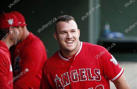 "Los Angeles Angels designated hitter Mike Trout smiles in the dugout after he scored on a home run by Brian Goodwin against the Texas Rangers during the first inning of a baseball game in Arlington, Texas. If Major League Baseball and the players' union can partially save its 2020 season, the potential 60-to 70-game season would be much shorter than the usual 162-game grind. It would look much more like a college baseball season. ""If there's 60 games on the schedule, someone like Mike Trout is going to play 60 games,"" former major league baseball player and college coach Tracy Woodson said"