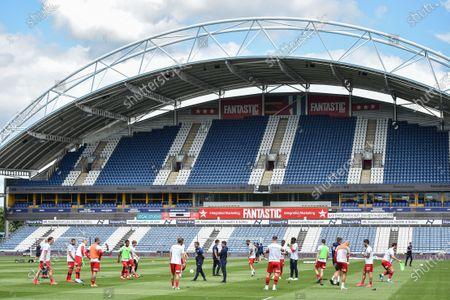 Wigan Athletic warm up in an empty John Smith Stadium.