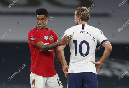 Manchester United's Marcus Rashford (L) greets Tottenham Hotspur's Harry Kane (R) at the end of the English Premier League soccer match between Tottenham Hotspur and Manchester United in London, Britain, 19 June 2020.