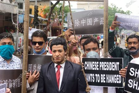 Protesters holding placards surround an effigy of the Chinese President Xi Jingping hanging during the demonstration. Protest against the Chinese intrusion inside Indian Territory and border brawl with Indian army where 20 of Indian soldiers were martyred on 15th June night at Galwan Valley in ladakh.