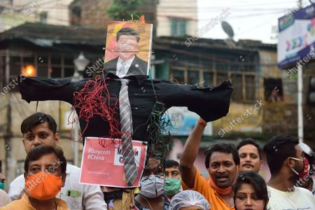Protesters carry an effigy of the Chinese president Xi Jingping during the demonstration. Protest against the Chinese intrusion inside Indian Territory and border brawl with Indian army where 20 of Indian soldiers were martyred on 15th June night at Galwan Valley in ladakh.