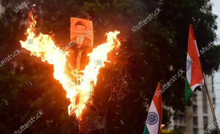 Protesters burning an effigy of the Chinese President Xi Jingping and Chinese flags during the demonstration. Protest against the Chinese intrusion inside Indian Territory and border brawl with Indian army where 20 of Indian soldiers were martyred on 15th June night at Galwan Valley in ladakh.