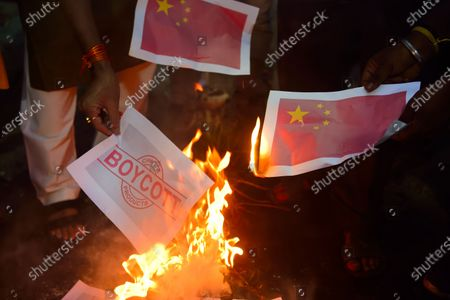 Protesters burning an effigy of the Chinese President Xi Jingping and placards during the demonstration. Protest against the Chinese intrusion inside Indian Territory and border brawl with Indian army where 20 of Indian soldiers were martyred on 15th June night at Galwan Valley in ladakh.