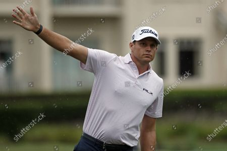 Nick Watney signals after a tee shot during the first round of the RBC Heritage Golf tournament at Harbour Town Golf Links in Hilton Head, S.C. Watney has tested positive for coronavirus and did not play in Friday's round
