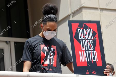 Players of the NBA Washington Wizards and WNBA Washington Mystics led by John Wall and Bradley Beal and Natasha Cloud of the Mystics march down the streets of DC to the MLK Memorial during a Black Lives Matter March