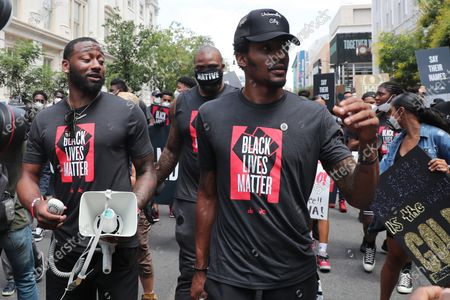 John Wall and Bradley Beal of the NBA Washington Wizards march down the streets of DC to the MLK Memorial during a Black Lives Matter March