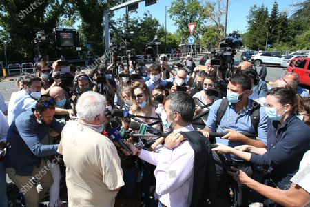 Italian Director of the department of Neurosurgery Hospital Le Scotte di Siena, Giuseppe Olivieri (C) talks to the media at the Siena hospital where the Italian driver Alex Zanardi is hospitalized after the road accident near Siena, Italy, 20 June 2020. According to reports, four-time paralympic champion and former Formula One driver Alex Zanardi was involved in a serious road accident on 19 June in the province of Siena while taking part in a race on his handbike during one of the stages of the relay of Obiettivo tricolore. Zinardi underwent a brain surgery after suffering a severe cranial trauma and is in serious condition, according to reports.