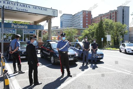 Police officers guard in front of the Siena hospital where the Italian driver Alex Zanardi is hospitalized after the road accident near Siena, Italy, 20 June 2020. According to reports, four-time paralympic champion and former Formula One driver Alex Zanardi was involved in a serious road accident on 19 June in the province of Siena while taking part in a race on his handbike during one of the stages of the relay of Obiettivo tricolore. Zinardi underwent a brain surgery after suffering a severe cranial trauma and is in serious condition, according to reports.
