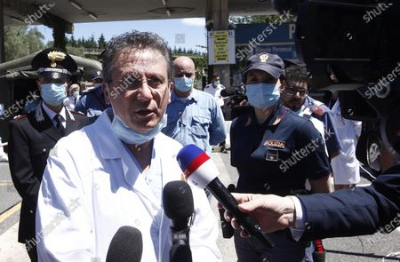 Italian doctor Sabino Scolletta (L) talks to the media at the Siena hospital where the Italian driver Alex Zanardi is hospitalized after the road accident near Siena, Italy, 20 June 2020. According to reports, four-time paralympic champion and former Formula One driver Alex Zanardi was involved in a serious road accident on 19 June in the province of Siena while taking part in a race on his handbike during one of the stages of the relay of Obiettivo tricolore. Zinardi underwent a brain surgery after suffering a severe cranial trauma and is in serious condition, according to reports.