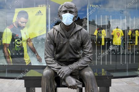 Face mask is put on the statue of late Watford manager Graham Taylor ahead of the English Premier League soccer match between Watford and Leicester City at the Vicarage Road Stadium in Watford, England