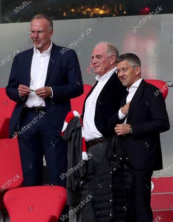 Bayern Munich board chairman Karl-Heinz Rummenigge (L), president Herbert Hainer (R) and Uli Hoeness Honorary President of FC Bayern Muenchen look on before the German Bundesliga soccer match between Bayern Munich and SC Freiburg in Munich, Germany, 20 June 2020.