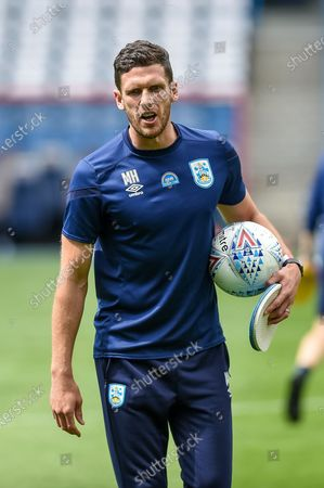 Huddersfield Town coach Mark Hudson warming up before the EFL Sky Bet Championship match between Huddersfield Town and Wigan Athletic at the John Smiths Stadium, Huddersfield