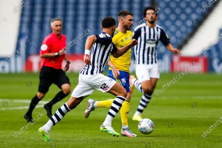 Scott Hogan of Birmingham City is challenged by Kieran Gibbs of West Bromwich Albion as Championship Football returns from it's Covid-19 enforced break