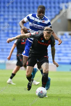 Stoke City's Ryan Shawcross (17) takes on Reading's Yakou Meite (19) during the EFL Sky Bet Championship match between Reading and Stoke City at the Madejski Stadium, Reading