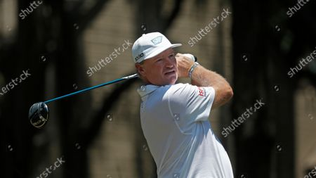 Stock Photo of Ernie Els of South Africa hits off the second tee during the third round of the RBC Heritage golf tournament, in Hilton Head Island, S.C