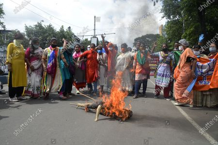 BJP mohila morcha activists burn effigy of Chinese President Xi Jingping during protest against CPI (M) journal Ganasakti near it's office.