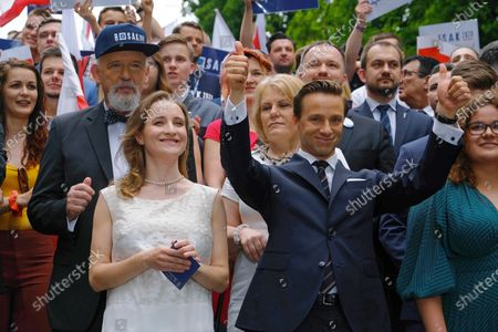 Stock Picture of One of the far-right Confederation leaders and presidential candidate Krzysztof Bosak (2R) with his wife Karina (2L), one of the far-right Confederation leaders Janusz Korwin-Mikke (L) during his election convention in Warsaw, Poland, 20 June 2020. Poland will hold its presidential election on 28 June 2020. Poles will be able to vote in polling stations with adherence to a strict sanitary regime, or by postal vote.