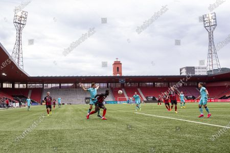 Thun's forward Simone Rapp (C-L) in action against Xamax's Johan Djourou (C-R) in front of empty stands during the Swiss Super League soccer match between Neuchatel Xamax FCS and FC Thun at the Stade de la Maladiere stadium in Neuchatel, Switzerland, 20 June 2020. All Super League soccer matches are played behind closed doors due to preventive measures against a second wave of the coronavirus COVID-19 pandemic.