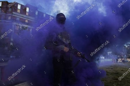 Flare smoke envelopes an armed supporter of Black Lives Matter (BLM) carrying a semi-automatic firearm at the base of the statue of Confederate general Robert E. Lee in Richmond, Virginia, USA, 20 June 2020. Following the death of George Floyd while in Minneapolis police custody protests of outrage have resulted in the removal of Confederate memorials in many parts of the country. Virginia Governor Ralph Northam's order for the removal of the statue of Confederate general Robert E. Lee is under an indefinite injuction due to a jugde's order. Removal of the statue has been demanded by Black Lives Matter supporters but opposed by conservative second amendment advocacy groups such as 'The Right to Bear Arms Virginia'.
