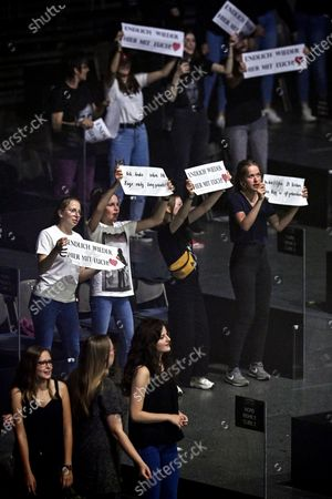 Spectators attend the first music concert in acrylic glass booths since the coronavirus crisis of German singer Wincent Weiss at Lanxess-Arena in Cologne, Germany, 20 June 2020. In order to comply with the corona rules, the spectators are placed in small plexiglass boxes in the interior, which are open towards the stage. According to the organizers, the concept is unique in Europe.