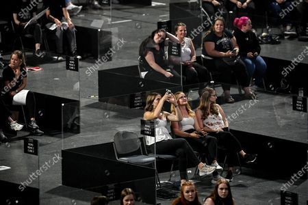 Stock Image of Spectators attend the first music concert in acrylic glass booths since the coronavirus crisis of German singer Wincent Weiss at Lanxess-Arena in Cologne, Germany, 20 June 2020. In order to comply with the corona rules, the spectators are placed in small plexiglass boxes in the interior, which are open towards the stage. According to the organizers, the concept is unique in Europe.