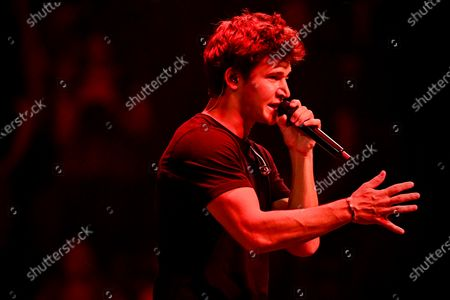 German singer Wincent Weiss performs during the first music concert with acrylic glass booths since the coronavirus crisis at Lanxess-Arena in Cologne, Germany, 20 June 2020. In order to comply with the corona rules, the spectators are placed in small plexiglass boxes in the interior, which are open towards the stage. According to the organizers, the concept is unique in Europe.