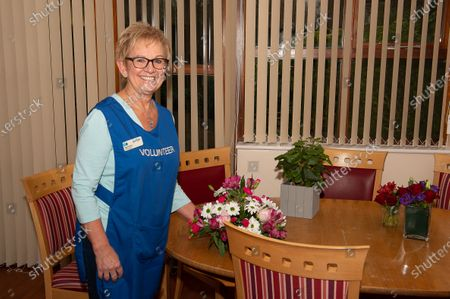 Stock Image of Volunteer Myra Finch. The Sue Ryder Duchess of Kent Hospice in Reading, Berkshire has been rated Outstanding by the Care Quality Commission. They have 15 in patient beds and are based near to the Royal Berkshire Hopsital in Reading