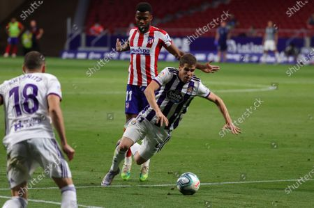 Stock Photo of Atletico de Madrid's french midfielder Thomas Lemar (L) and Valladolid´s defender Pablo Hervias, during the Spanish LaLiga soccer match between Atletico de Madrid and Real Valladolid, played at the Wanda Metropolitano in Madrid, Spain, 20 June 2020.