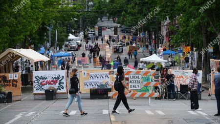 A closed streets near a police station, abandoned by police, is pictured in the Capitol Hill neighborhood, known as the 'Occupied Protest' in Seattle, Washington, USA, 20 June 2020. For several weeks activists have occupied part of the Capitol Hill neighborhood to protest police brutality and support the Black Lives Matters movement. While the occupation has been relatively peaceful, a man was shot and killed just outside of the zone early in the morning of 20 June.