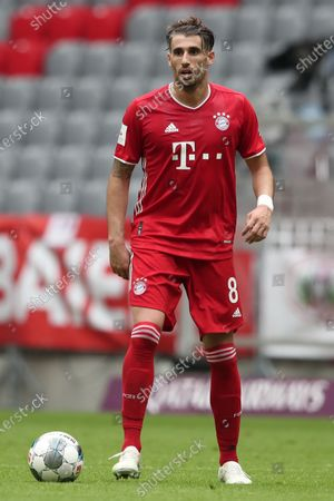Javier Martinez of FC Bayern Muenchen runs with the ball during the Bundesliga match between FC Bayern Muenchen and Sport-Club Freiburg at Allianz Arena in Munich, Germany, 20 June 2020.