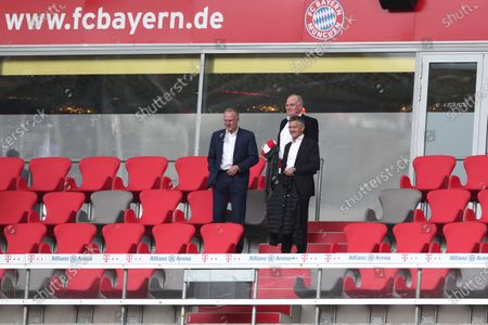 (L-R) Karl-Heinz Rummenigge, CEO of FC Bayern Muenchen looks on with Herbert Hainer, President of FC Bayern Muenchen and Uli Hoeness, Honorary President of FC Bayern Muenchen look on during the Bundesliga match between FC Bayern Muenchen and Sport-Club Freiburg at Allianz Arena in Munich, Germany, 20 June 2020.