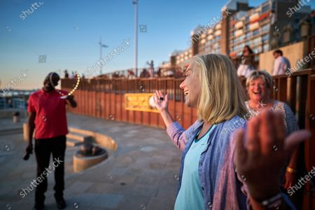 Dutch Minister of Foreign Trade and Development Cooperation Sigrid Kaag (R) gestures at the camera during a digital edition of the Night of the Refugee in Scheveningen, The Netherlands, 20 June 2020 (issued 21 June 2020). Due to coronavirus prevention measures, the 11th edition of the annual event differed from previous years. This year, runners did not leave from a central point, but instead walked in their own environment.