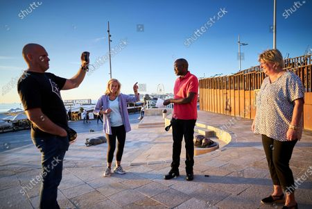 Dutch Minister of Foreign Trade and Development Cooperation Sigrid Kaag (2-L), ambassador for the Refugee Foundation Andrew Makkinga (2-R) and the foundation's director, Tineke Ceelen (R) chat while being filmed by a camera (L) during a digital edition of the Night of the Refugee in Scheveningen, The Netherlands, 20 June 2020 (issued 21 June 2020). Due to coronavirus prevention measures, the 11th edition of the annual event differed from previous years. This year, runners did not leave from a central point, but instead walked in their own environment.