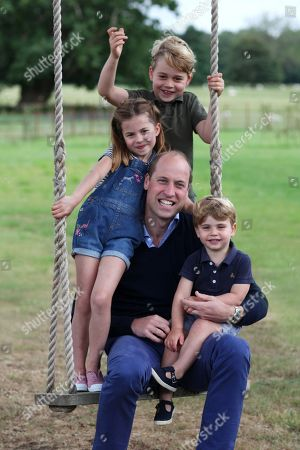 Stock Photo of Undated handout photo released by Kensington Palace, which was taken by The Duchess earlier this month in Norfolk, of Prince William, Prince George, Princess Charlotte and Prince Louis in new pictures marking both his birthday and Father's Day. Prince William turns 38 on Sunday.