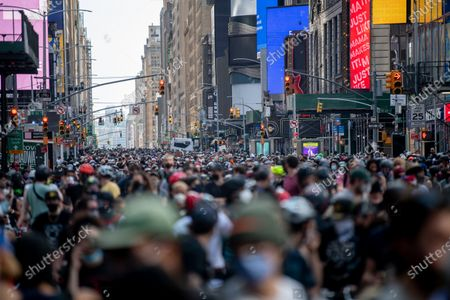 Protesters on bicycles assemble in Times Square in New York City. Global protests sparked after the police killing of George Floyd in Minneapolis.