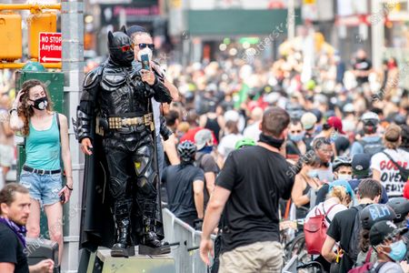 A man dressed as Batman attends as protesters on bicycles assemble in Times Square in New York City. Global protests sparked after the police killing of George Floyd in Minnapolis.