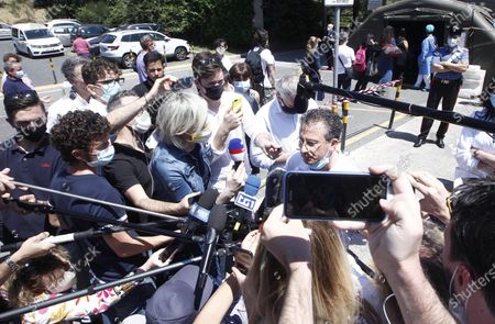 Italian doctor Sabino Scolletta (R) addresses the media outside the Siena hospital, where the Italian driver Alex Zanardi is hospitalized after the road accident during one of the stages of the relay of Obiettivo tricolore, near Siena, Italy, 21 June 2020. Four-time paralympic champion and former Formula One driver Alex Zanardi was involved in a serious road accident on 19 June in the province of Siena while taking part in a race on his handbike during one of the stages of the relay of Obiettivo tricolore. Zinardi underwent remains in an artificial coma after suffering a severe cranial trauma and is in serious condition, according to reports.
