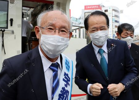 Former president of Japan Federation of Bar Associations Kenji Utsunomiya (L) is greeted by former Prime Minister Naoto Kan (R) upon his arrival as he delivers a campaign speech for the Tokyo gubernatorial election campaign in Tokyo on Saturday, June 20, 2020. Official campaign for the July 5 Tokyo gubernatorial election with 22 candidates including Tokyo Governor Yuriko Koike started on June 18.