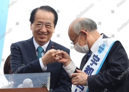 Former Japanese Prime Minister Naoto Kan (L) exchanges a fist bump with Kenji Utsunomiya (R), former president of Japan Federation of Bar Associations as he delivers a speech for the Tokyo gubernatorial election campaign in Tokyo on Saturday, June 20, 2020. Official campaign for the July 5 Tokyo gubernatorial election with 22 candidates including Tokyo Governor Yuriko Koike started on June 18.
